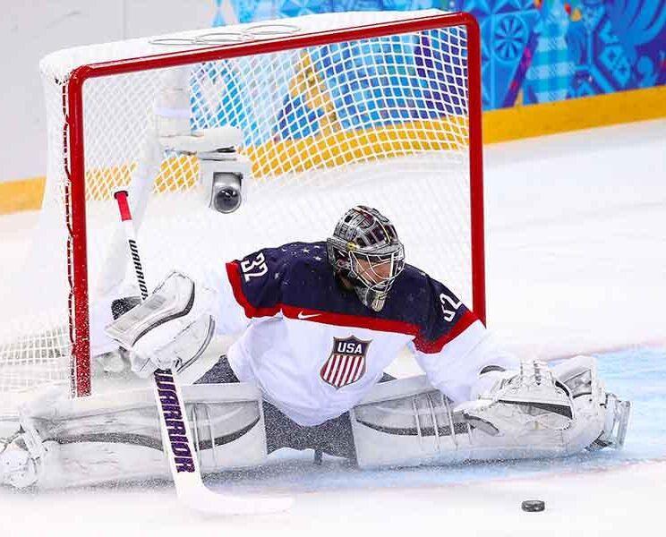 A man plays ice hockey